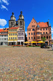 Wittenberg market place. View from the Wittenberg market place towards the old city church St. Marien with historic buildings in the front. St. Marien is the royalty free stock photography