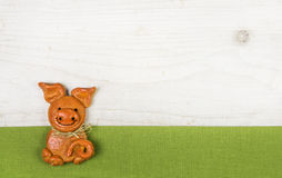 Witty and humorously new years greeting card with a handmade pig. Of salt paste with a green fabric frame Stock Images