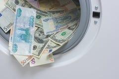 Witwassen van geld. Het schoonmaken van het geld concept Stock Fotografie