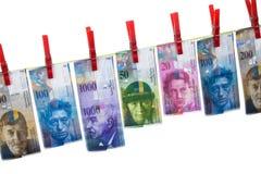 Witwassen van geld, Zwitserse franken Stock Afbeelding