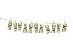 Witwassen van geldconcept met dollars Stock Afbeeldingen