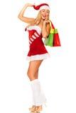 Święty Mikołaj dziewczyna z zakupami Obrazy Royalty Free