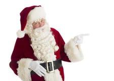 Święty Mikołaj Wskazuje W kierunku kopii przestrzeni Obrazy Royalty Free