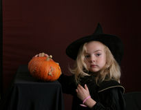 Wizard. Toddler with pumpkin in wizard hat Royalty Free Stock Image