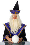 Wizard. With the glass ball royalty free stock photo