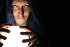 Wizard. With glowing magical orb close-up stock photography
