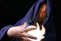 Wizard. With glowing magical orb close-up royalty free stock images