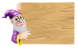 Wizard and blank wooden sign Stock Image