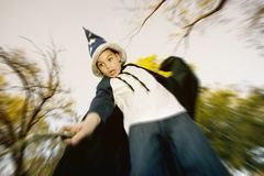 Wizard Boy with a Stick Wand Royalty Free Stock Images