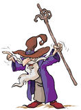 Wizard cartoon character. Cartoon illustration of a  Wizard in position with a magic wand in hand Stock Images