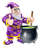 Wizard and cauldron. A friendly old wizard character stirring a big black cauldron Stock Image
