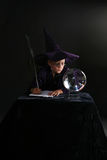 Wizard child consulting crystal ball Royalty Free Stock Photos