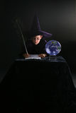 Wizard child writing with feather quill Royalty Free Stock Photo