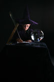 Wizard child writing a spell Royalty Free Stock Photos