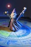 Wizard Figurine on Tarot Board. On Dark Background Royalty Free Stock Photo