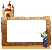 A wizard in front of an empty white signage with a castle Royalty Free Stock Images