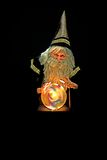 Wizard and gazing ball. Magician is using his crystal ball to cast a spell Royalty Free Stock Photography