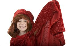 Wizard of Good Magic. Boy Playing Wizard in Red Sparkling Hat and Coat Royalty Free Stock Images