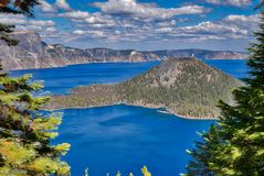 Wizard Island is in Crater Lake National Park, Oregon. Crater Lake National Park is the only one in Oregon. Wizard Island Is a well known larger island here royalty free stock image