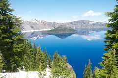 Wizard Island of Crater Lake during the summer. With snow Royalty Free Stock Images