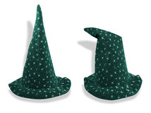 Wizard like hat in two poses. A wizard like hat shown on an isolated background in two different poses. Clipping path supplied Stock Photo