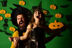 Wizard and little witch in black hats. Halloween party royalty free stock photos