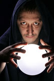 Wizard with magical ball Stock Photography