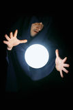 Wizard with magical sphere. Wizard with glowing magical sphere close-up Stock Image