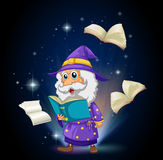 A wizard with many books Stock Images