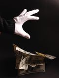 Wizard with money. White gloved hands holding money Stock Photography