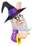 Wizard peeping round sign Royalty Free Stock Photos