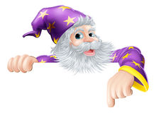Wizard pointing down at sign Stock Photography