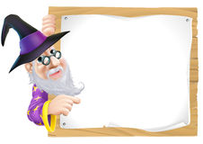 Wizard pointing at sign Stock Photography