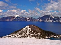 Wizard Scott. Wizard Island with Mt. Scott in the distance - Crater Lake National Park, OR royalty free stock images