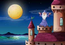 A wizard standing above a castle port Royalty Free Stock Photo