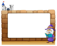 A wizard standing beside an empty board Stock Photography