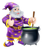 Wizard stirring cauldron. Cartoon of a happy old wizard character stirring a big black cauldron with bubbling green brew in it Stock Photography