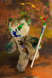Wizard teddy bear with colorful paintbrush Royalty Free Stock Images