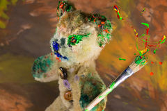 Wizard teddy bear toy with paint burst on the paintbrush Royalty Free Stock Images