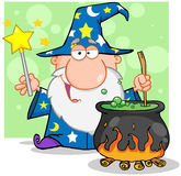 Wizard Waving With Magic Wand And Preparing A Poti Stock Photo
