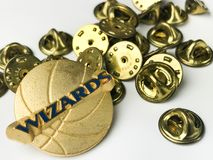 Washington Wizards Lapel Pin and Pin backs. Wizards lapel pin and a bunch of pin backs to protect the wearer of the pin Royalty Free Stock Image