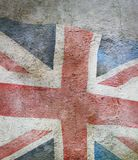 wizerunek flaga zlany królestwo przeciw staremu ściennemu tłu fotografia stock