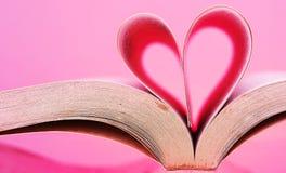 Wizerunek książkowe strony w kierowego kształt różowy tło Obraz Royalty Free
