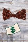 Wizerunek pieniądze, kawowa fasola Obraz Stock