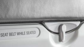 wizerunek przymocowywa pas bezpieczeństwa podczas gdy posadzony znak Obraz Royalty Free