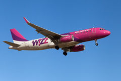 Wizz Air Airbus A320. A Wizz Air Airbus A320-200 approaching to El Prat Airport in Barcelona, Spain stock photos