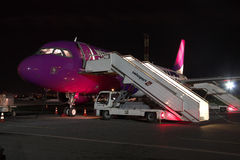 Wizz Air Airbus A320 at night Stock Photo