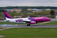 Wizz Air going fast. Wizz Air Airbus A320 landing Royalty Free Stock Image