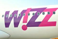 Wizzair Fluglinienfirmenzeichen Lizenzfreies Stockbild