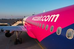 Wizzair plane in airport. Wizz air logo close up. Warsaw, Poland - May 29, 2018: Wizzair plane in airport. Wizz air logo close up stock image